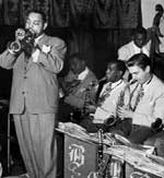 Benny Carter playing in front of a band