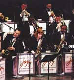 Three saxophone players in a jazz orchestra