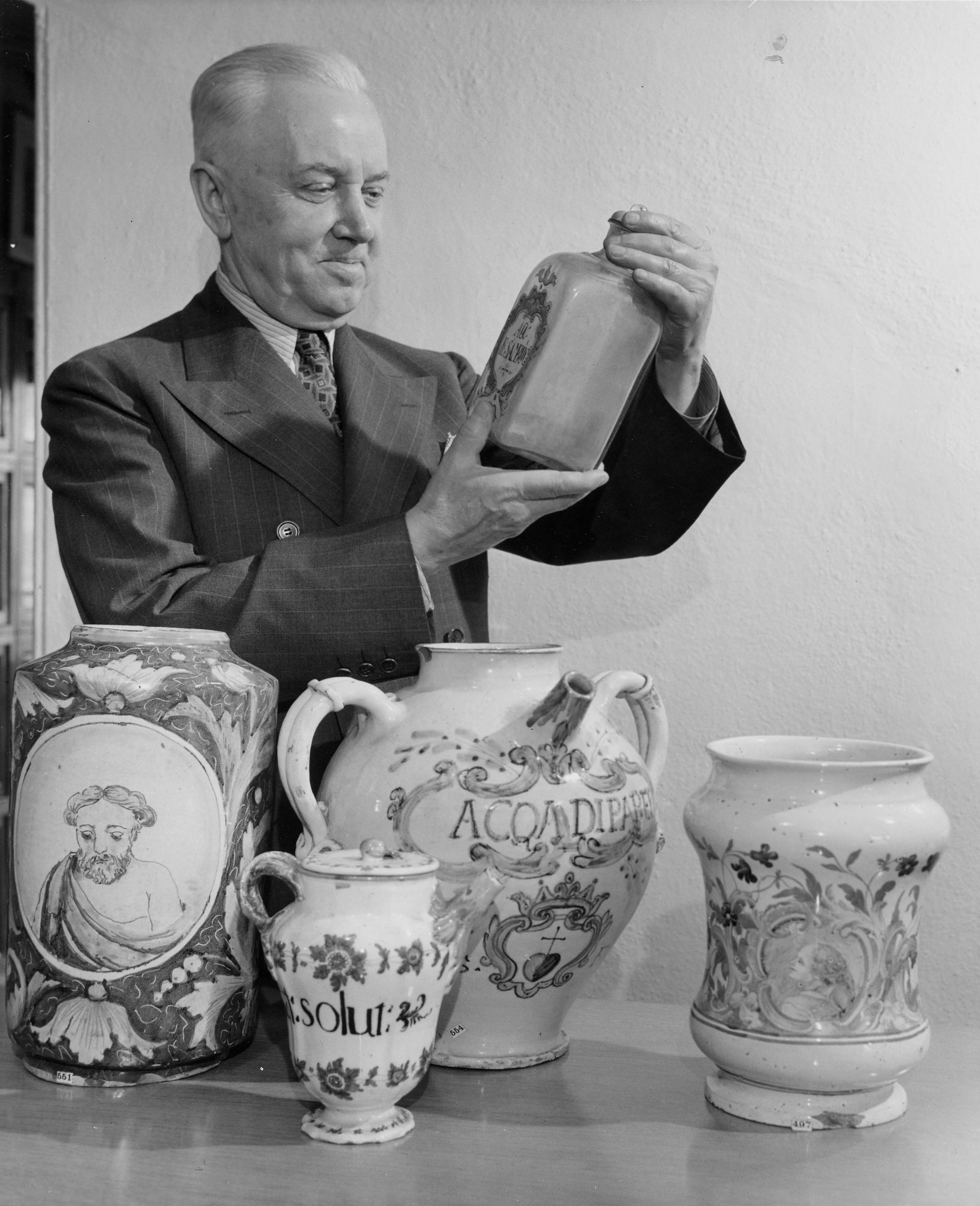 Charles Whitebread Examines Jars from the Squibb Collection