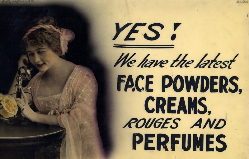 Shop window advertising sign for face powder, creams, rouges and perfumes