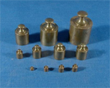 A set of seven copper-soldered wooden volumetric measures from largest to smallest, 1 dekaliter (a dekaliter is 10 liters), 1/2 dekaliter (5 liters), 2 liters, 1 liter, 5 deciliters (a deciliter is 1/10 of a liter or 100 cubic centimeters), 2 deciliters, and 1 deciliter.