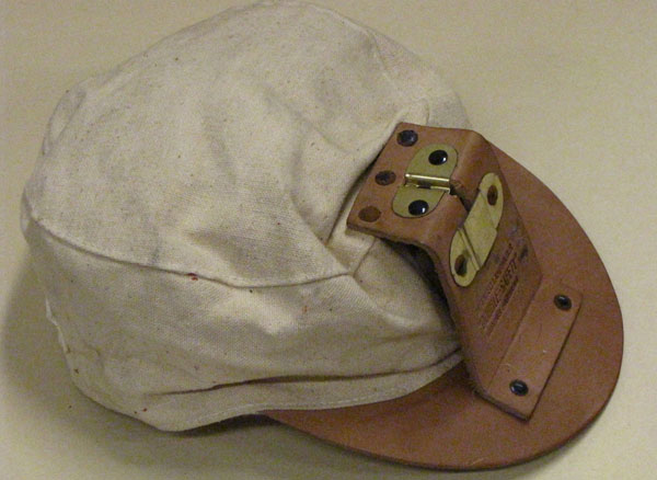 20th c. Canvas Mining Cap & Lamp Bracket