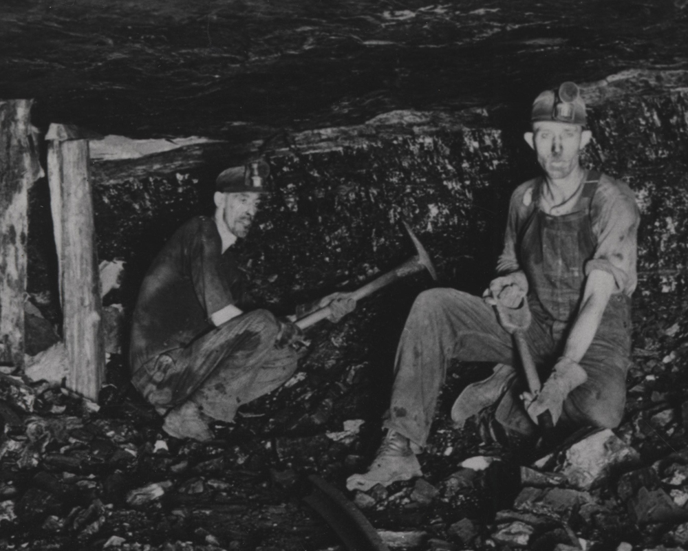 Image of a Miner wearing his Carbide Lamp