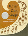Front cover of the book When Clay sings, a brown and cream colored swirl.