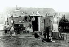 Mr. and Mrs. Curry in front of their sod house.